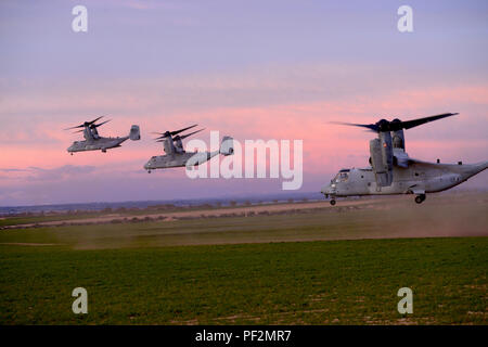 Three U.S. Marine Corps MV-22B Osprey aircraft, flown by Marine Medium Tiltrotor Squadron 263, Special Purpose Marine Air Ground Task Force, with personnel from the U.S.  Army 1st Battalion, 503rd Infantry Regiment, 173rd Airborne Brigade and soldiers from the Spanish Armed Forces Airborne Brigade (BRIPAC), take off after an air assault during the Exercise Sky Soldier 16, Feb. 27, 2016, at Chinchilla training area in Spain. The training objective of Exercise Sky Soldier 16 is to enhance the brigade's 1st Battalion, 503rd Infantry Regiment readiness for multinational contingency operations and  - Stock Photo