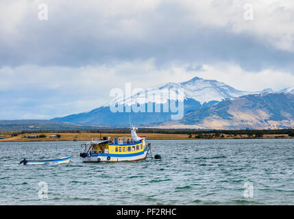 Boat in Admiral Montt Gulf, Puerto Natales, Ultima Esperanza Province, Patagonia, Chile - Stock Photo