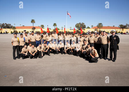 U.S. Navy Rear Admiral Bruce Gillingham, center, commander of Navy Medicine West, poses for a photo with drill instructors and senior drill instructors of Company B, 1st Recruit Training Battalion, Recruit Training Regiment at Marine Corps Recruit Depot San Diego, Calif., Feb. 12, 2016. Gillingham was the Parade Reviewing Officer for the Company B graduation ceremony. (U.S. Marine Corps photo by Sgt. John C. Lamb/Released)
