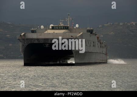151230-N-IL474-052  SOUDA BAY, Greece (Dec. 30, 2015) – The Military Sealift Command Expeditionary Fast Transport ship , USNS Choctaw County (T-EPF 2), arrives in Souda Bay for a scheduled port visit Dec. 30, 2015.  Choctaw County is the second of 10 vessels designed for rapid intra-theater transportation of troops and military equipment.  (U.S. Navy photo by Heather Judkins/Released) - Stock Photo
