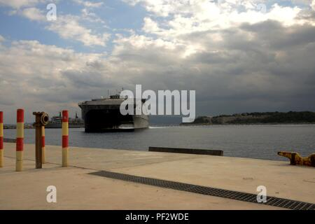 151230-N-IL474-086  SOUDA BAY, Greece (Dec. 30, 2015) – The Military Sealift Command Expeditionary Fast Transport ship, USNS Choctaw County (T-EPF 2),  arrives in Souda Bay for a scheduled port visit Dec. 30, 2015.  Choctaw County is the second of 10 vessels designed for rapid intra-theater transportation of troops and military equipment.  (U.S. Navy photo by Heather Judkins/Released) - Stock Photo