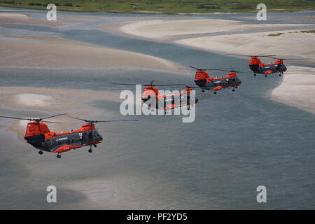A flight of four HH-46D Seaknight helicopters make one of their final formation flights over North Carolina's Outer Banks in August 2015, weeks before the Marine Corps turned the aircraft over to the Navy as the Corps' ended its search and rescue mission.  The helicopters were a familiar sight in Eastern North Carolina skies for decades as Marine Transport Squadron 1 conducted SAR and medical transport flights for both military and civilian emergencies, including the rescue of 399 people directly threatened by flood after Hurricane Floyd washed through eastern North Carolina in September 1999. - Stock Photo