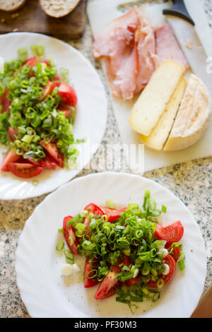 Tomatoes, scallions & basil salad with ham sandwiches and cheese - Stock Photo