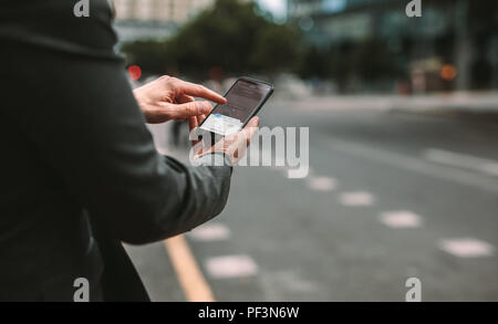 Online ride sharing and carpool mobile application. Rideshare taxi app on smartphone screen. Male commuter using online transportation service. - Stock Photo