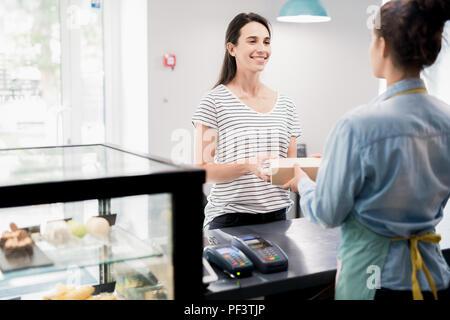 Satisfied Customer in Cake Shop - Stock Photo