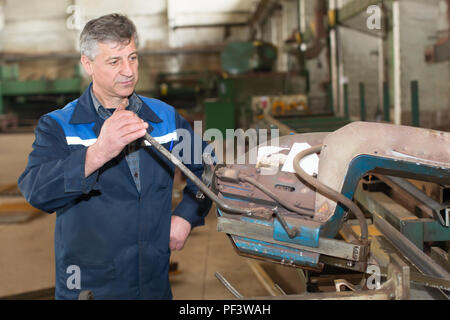 Belarus, Gomel, 25 April 2018. Metallurgical plant. Working behind a metal-cutting machine - Stock Photo