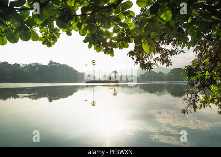 Last sun at Kandy Lake with view to the island, Kandy, Sri Lanka - Stock Photo