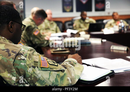U.S. Army Maj. Julian Milligan, executive officer of the 151st Expeditionary Signal Battalion, 228th Theater Tactical Signal Brigade, South Carolina National Guard, takes notes during a meeting with leaders assigned to the 2d Theater Signal Brigade, Aug. 13, 2018 in Wiesbaden, Germany. (U.S. Army photo by William B. King) - Stock Photo