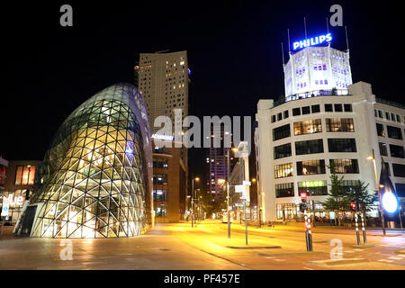 EINDHOVEN, NETHERLANDS - JUNE 5, 2018: Night view of the old Philips factory building and modern futuristic building in the city centre of Eindhoven, - Stock Photo