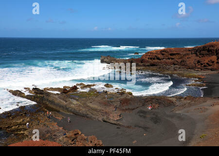 Breathtaking panoramic view of El Golfo with Atlantic Ocean waves crashing on the coast, Lanzarote, Canary Islands - Stock Photo
