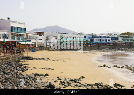 LANZAROTE, SPAIN - APRIL 18, 2018: Beautiful view of Playa Blanca beach and village, Lanzarote, Canary Islands, Spain - Stock Photo