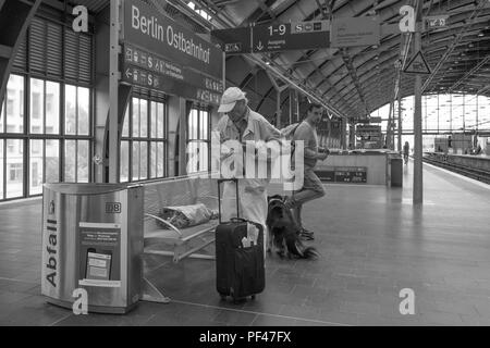 Berlin, Germany, 1st September 2017, Two Commuters, and a dog, waiting, at Berlin Ostbahnhof, Bahnhof, © Peter SPURRIER, - Stock Photo