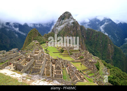 Machu Picchu on a Rainy Day, UNESCO World Heritage Site in Cusco Region, Urubamba Province, Peru, Archaeological site - Stock Photo