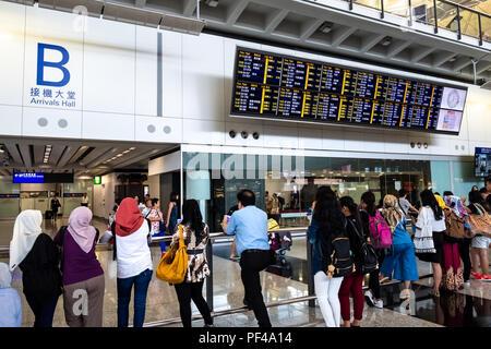 Lantau, Hong Kong  - August 05, 2018 :  Passengers arrival at Hong Kong International Airport - Stock Photo