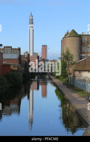 Part of the canal network in and around the city centre of Birmingham, UK.  The BT telecommunications tower is visible in the distance. - Stock Photo
