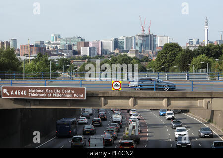 A view above the Aston Expressway urban motorway, with Birmingham city centre skyline in the distance. - Stock Photo