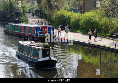 People enjoying warm spring day along the banks of River Lea in Clapton, London England United Kingdom UK - Stock Photo