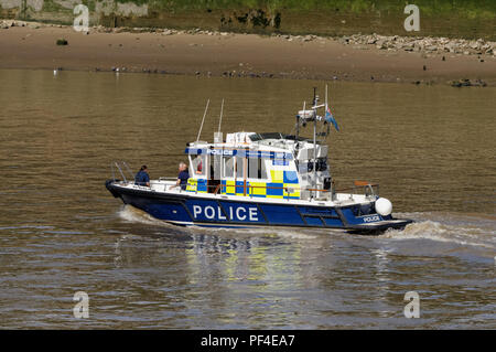 Police patrol boat on the River Thames in London England United Kingdom UK - Stock Photo