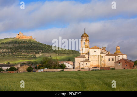 The town of Castrojeriz seen from the Camino de Santiago the way of St James with its templar castle and the Coleegiata de Santa Maria del Manzano - Stock Photo