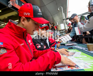 Silverstone Circuit, UK. 19th Aug, 2018. FIA World Endurance Championship; Thomas Laurent (FRA) of the Rebellion R13 Gibson LMP1 racing car from Rebellion Racing (CHE) signing autographs outside the pit garage at Round 3 of the FIA World Endurance Championship at Silverstone Credit: Action Plus Sports/Alamy Live News - Stock Photo