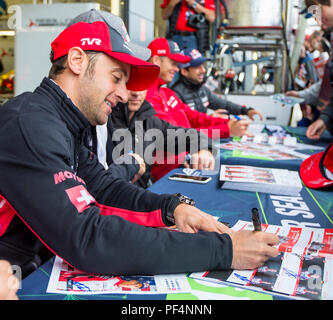 Silverstone Circuit, UK. 19th Aug, 2018. FIA World Endurance Championship; Mathias Beche (SUI) of the Rebellion R13 Gibson LMP1 racing car from Rebellion Racing (CHE) signing autographs outside the pit garage at Round 3 of the FIA World Endurance Championship at Silverstone Credit: Action Plus Sports/Alamy Live News - Stock Photo