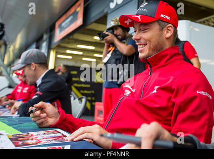 Silverstone Circuit, UK. 19th Aug, 2018. FIA World Endurance Championship; Andre Lotterer (DEU) of the Rebellion R13 Gibson LMP1 racing car from Rebellion Racing (CHE) signing spectator autographs outside the pit garage during Round 3 of the FIA World Endurance Championship at Silverstone Credit: Action Plus Sports/Alamy Live News - Stock Photo