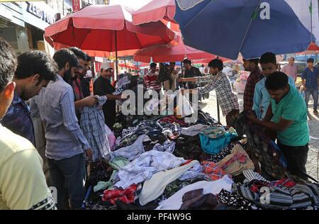Srinagar, Indian-controlled Kashmir. 19th Aug, 2018. Kashmiri Muslims shop ahead of Eid Al-Adha in Srinagar city, the summer capital of Indian-controlled Kashmir, Aug. 19, 2018. Credit: Javed Dar/Xinhua/Alamy Live News - Stock Photo