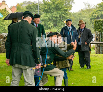 Haddington, UK. 19 August 2018.  The Royal Company of Archers, a ceremonial unit known as the Queen's Bodyguard For Scotland stages a clout archery shoot as part of Haddington 700 events taking place during 2018 to celebrate the granting of a charter by Robert the Bruce to the town in 1318, confirming Haddington's right to hold a market and collect customs. Children had a chance to practise archery with bows and arrows while John McMillan, Provost of East Lothian watches - Stock Photo