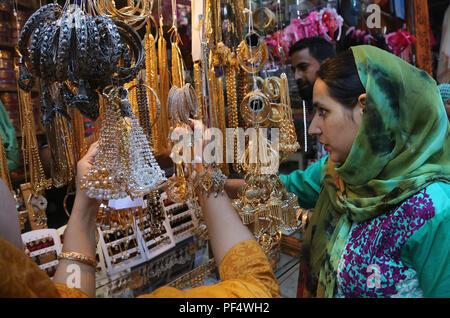 Srinagar, Indian-controlled Kashmir. 19th Aug, 2018. Kashmiri Muslim women buy artificial jewellery ahead of Eid Al-Adha in Srinagar city, the summer capital of Indian-controlled Kashmir, Aug. 19, 2018. Credit: Javed Dar/Xinhua/Alamy Live News - Stock Photo