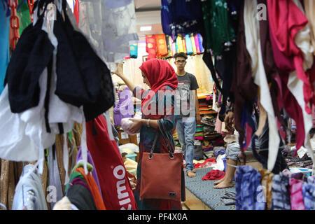 Srinagar, Indian-controlled Kashmir. 19th Aug, 2018. A Kashmiri Muslim woman shops ahead of Eid Al-Adha in Srinagar city, the summer capital of Indian-controlled Kashmir, August 19, 2018. Credit: Javed Dar/Xinhua/Alamy Live News - Stock Photo