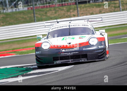 Silverstone Circuit, UK. 19th Aug, 2018. FIA World Endurance Championship; The Porsche 911 RSR LMGTE Pro racing car from Porsche GT Racing Team (DEU) driven by Michael Christensen (DNK) and Keven Estre (FRA) during Round 3 of the FIA World Endurance Championship at Silverstone Credit: Action Plus Sports/Alamy Live News - Stock Photo