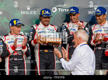 Silverstone Circuit, UK. 19th Aug, 2018. FIA World Endurance Championship; Fernando Alonso (ESP) of the Toyota TS050 Hybrid LMP1 racing car from Toyota Gazoo Racing Team (JPN) on the winners podium receiving a special award Credit: Action Plus Sports/Alamy Live News - Stock Photo