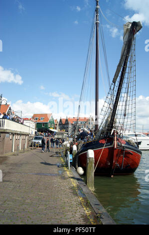 Traditional sailing craft alongside Volendam harbour, Netherlands - Stock Photo
