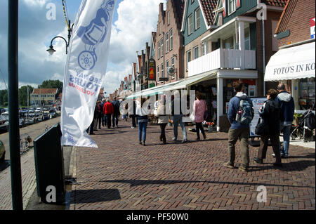 The shopping area along Volendam Harbour front, Netherlands - Stock Photo