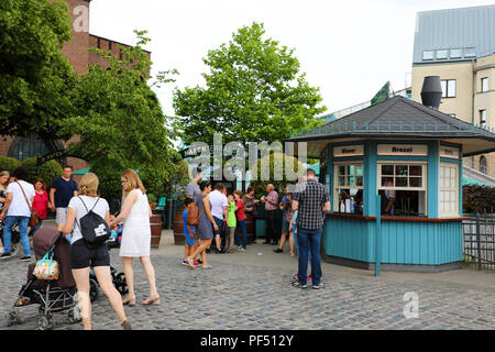 COLOGNE, GERMANY - MAY 31, 2018: people eating street food from kiosk in Cologne, Germany - Stock Photo