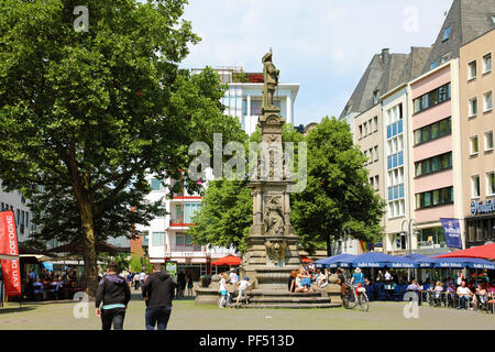 COLOGNE, GERMANY - MAY 31, 2018: tourists in Old Market (Alter Markt) square, Cologne, Germany - Stock Photo