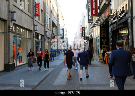 COLOGNE, GERMANY - MAY 31, 2018: shopping street Hohe Strasse with walking people. Hohe Strasse and Schilder Gasse are shopping street in the old town - Stock Photo