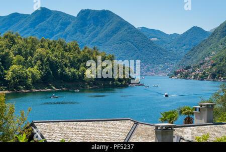 Comacina Island as seen from Ossuccio, on Lake Como, Lombardy, Italy. - Stock Photo