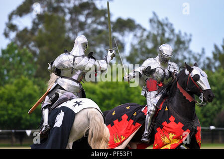 Two knights compete during re-enactment of medieval jousting tournament - Stock Photo