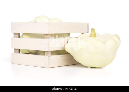 Group of two whole summer white pattypan squash with wooden crate isolated on white background - Stock Photo