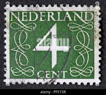 Used franked Nederland Netherlands Stamp, Green 4c Four Cent - Stock Photo