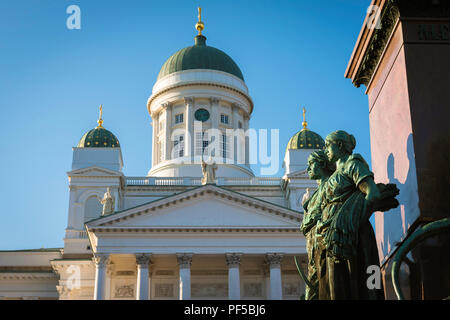 Helsinki Finland, view of the Lutheran Cathedral and statues of Nordic women sited on the Alexander ll Monument in Senate Square, Helsinki, Finland. - Stock Photo