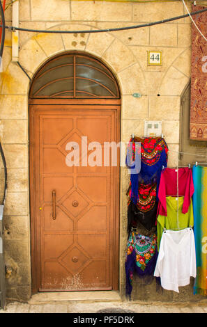 10 May 2018 An old steel door to an ancient building in the Arab Souk market. Close to the Via Dolorosa in the walled city of Jerusalem Israel shop st - Stock Photo