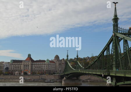 Liberty bridge (Szabadság híd), Budapest, 1896, designed by János Feketeházy in Art Nouveau style with Géllert spa hotel on the opposite shore in Buda - Stock Photo
