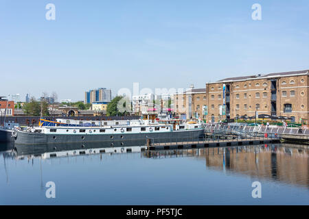 Converted barge houseboat at West India Quay, Canary Wharf, London Borough of Tower Hamlets, Greater London, England, United Kingdom - Stock Photo