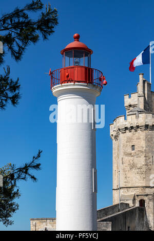 Lighthouse in the port of La Rochelle on the coast of the Poitou-Charentes region of France. The tower with the flag is the Tour de la Chaine which da - Stock Photo