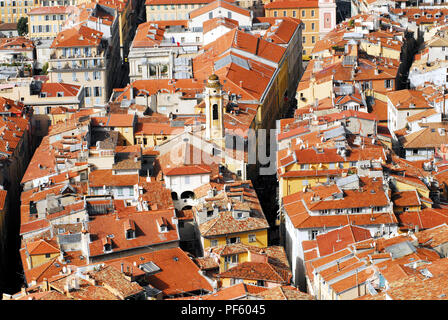 A cityscape of the red tiled roof tops of beautiful Nice, France. - Stock Photo