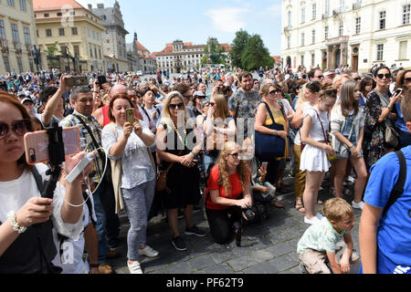 Crowds of tourists watching the Changing of the Guard ceremony at Prague Castle, Czech Republic. - Stock Photo