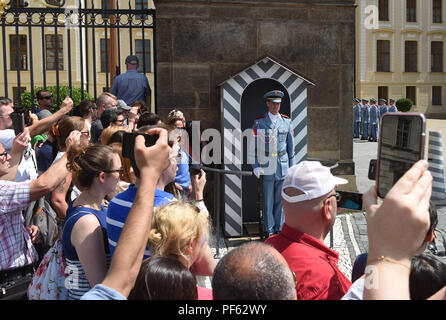Crowds of tourists watching Changing of the Guard ceremony at Prague Castle, Czech Republic. - Stock Photo