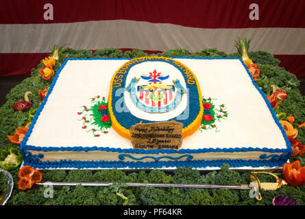 180816-N-WF272-1002 SAN DIEGO (Aug. 16, 2018)  A ceremonial birthday cake is set up in the hangar bay of the amphibious assault ship USS Bonhomme Richard (LHD 6) prior to a celebration of the ship's 20th birthday. Commissioned Aug. 15, 1998, Bonhomme Richard is the third ship to bear the name, the sixth Wasp-class ship, and the last amphibious assault ship in the Navy commissioned in the 20th century. (U.S. Navy photo by Mass Communication Specialist 1st Class Diana Quinlan) - Stock Photo